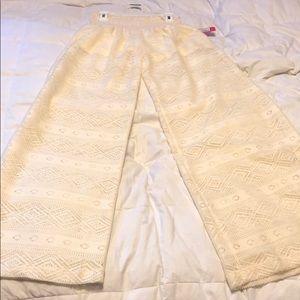 Cream, high waisted sheer leg fun pants!